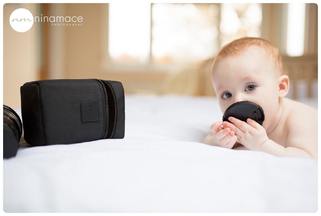 baby eating lens cap