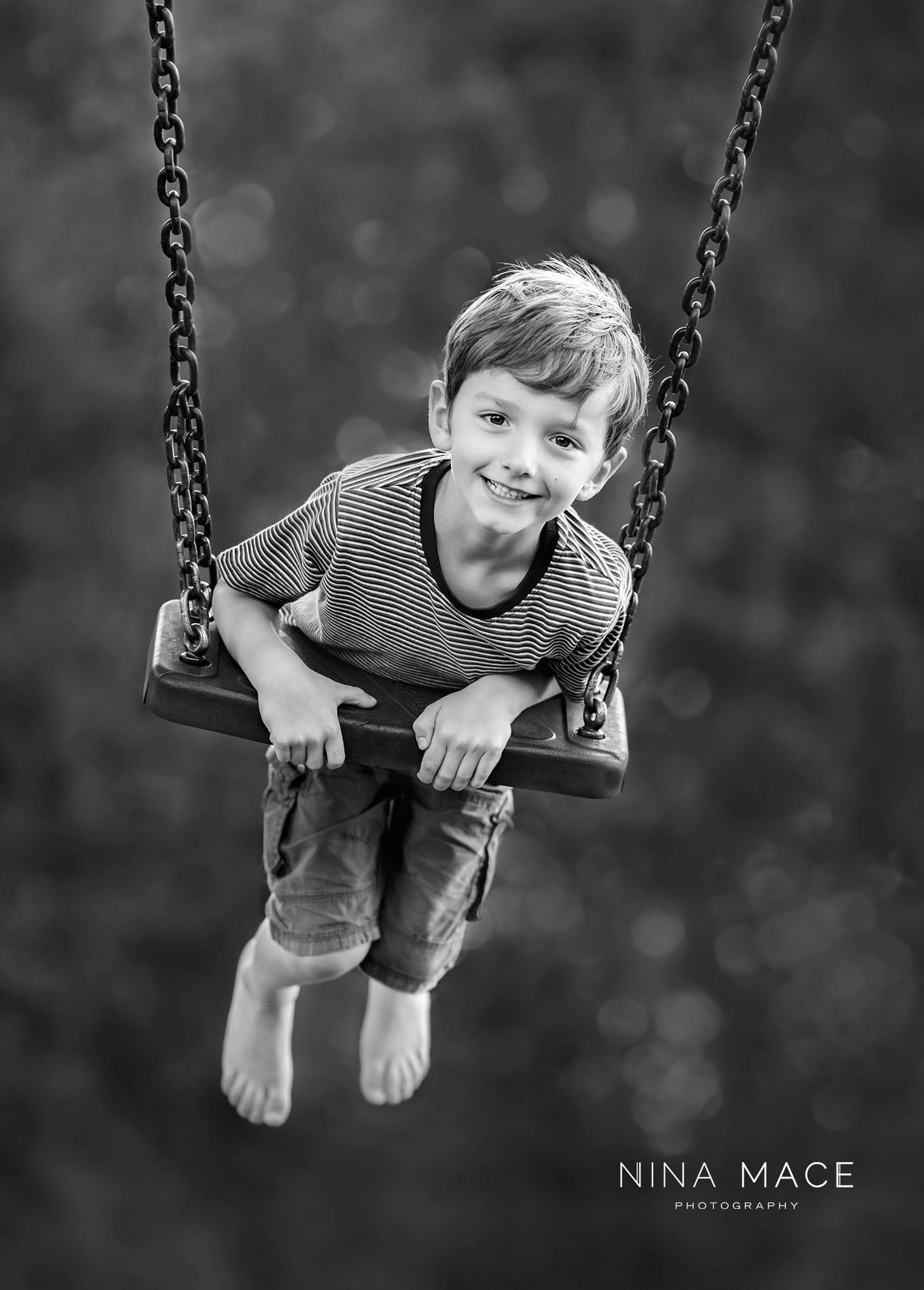 boy on swing photograph