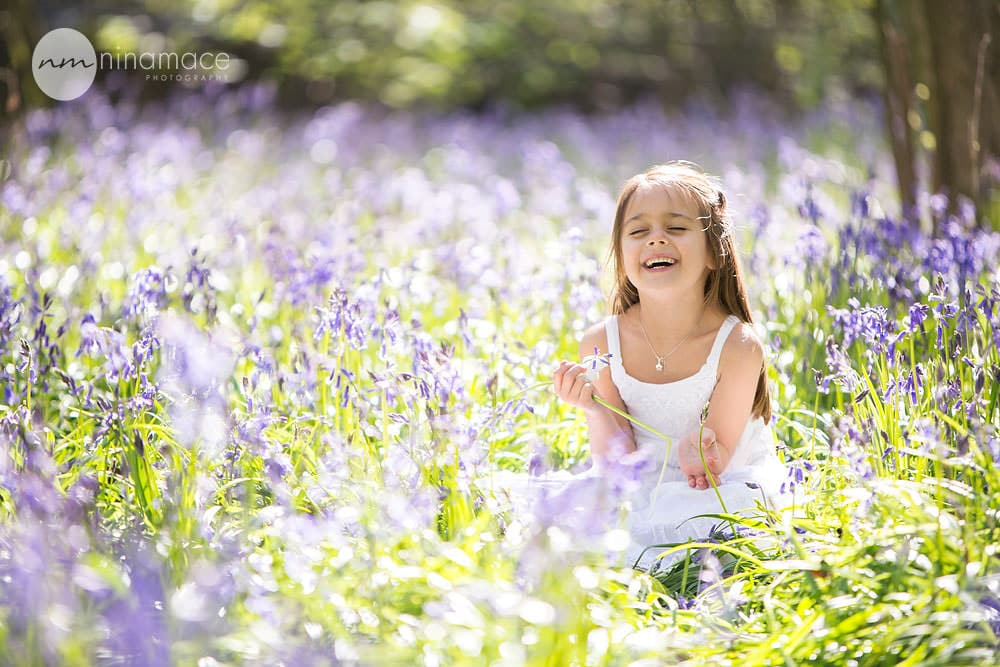 laughing girl in bluebells