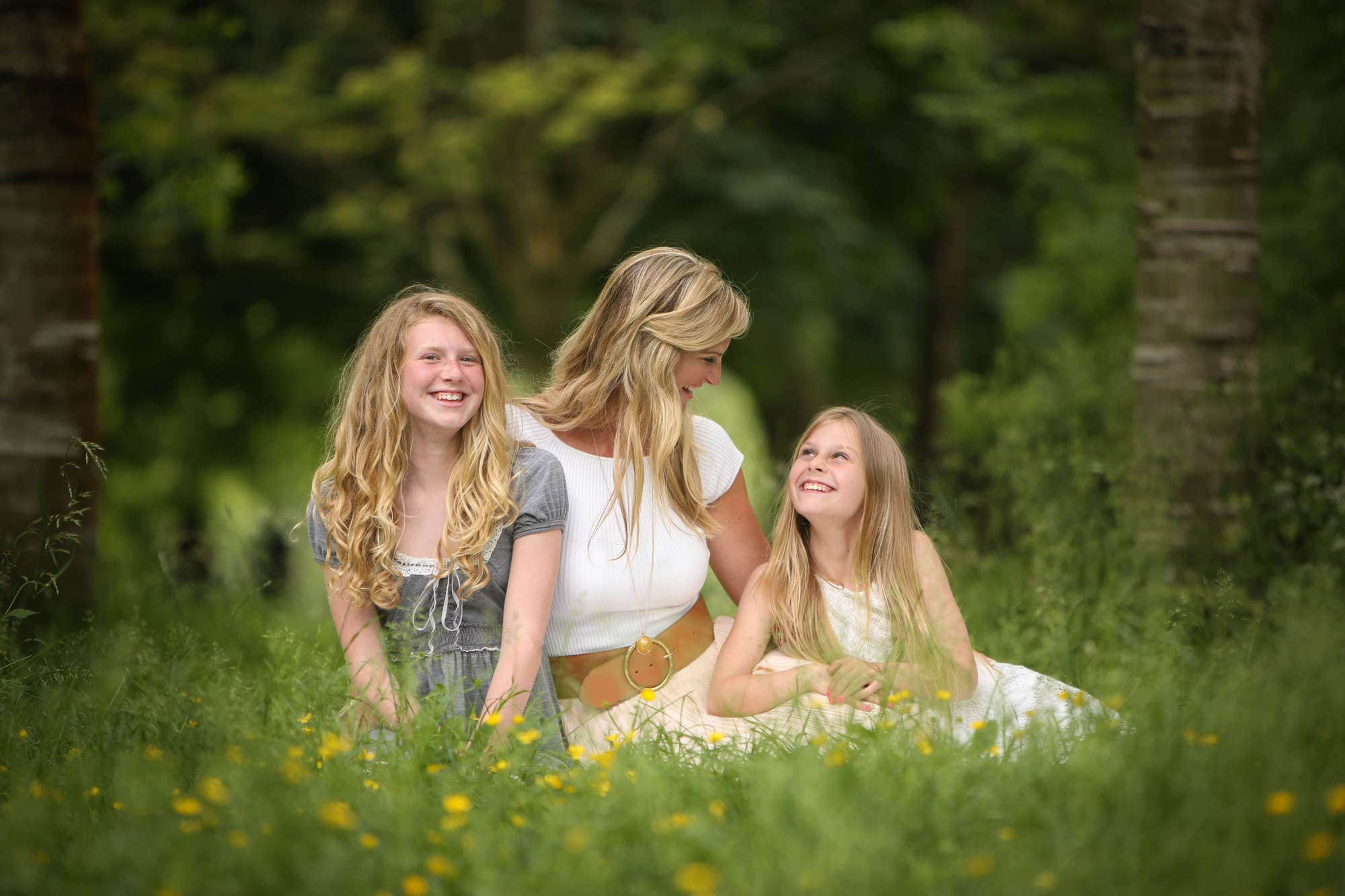 Mum and her daughters being photographed in Surrey