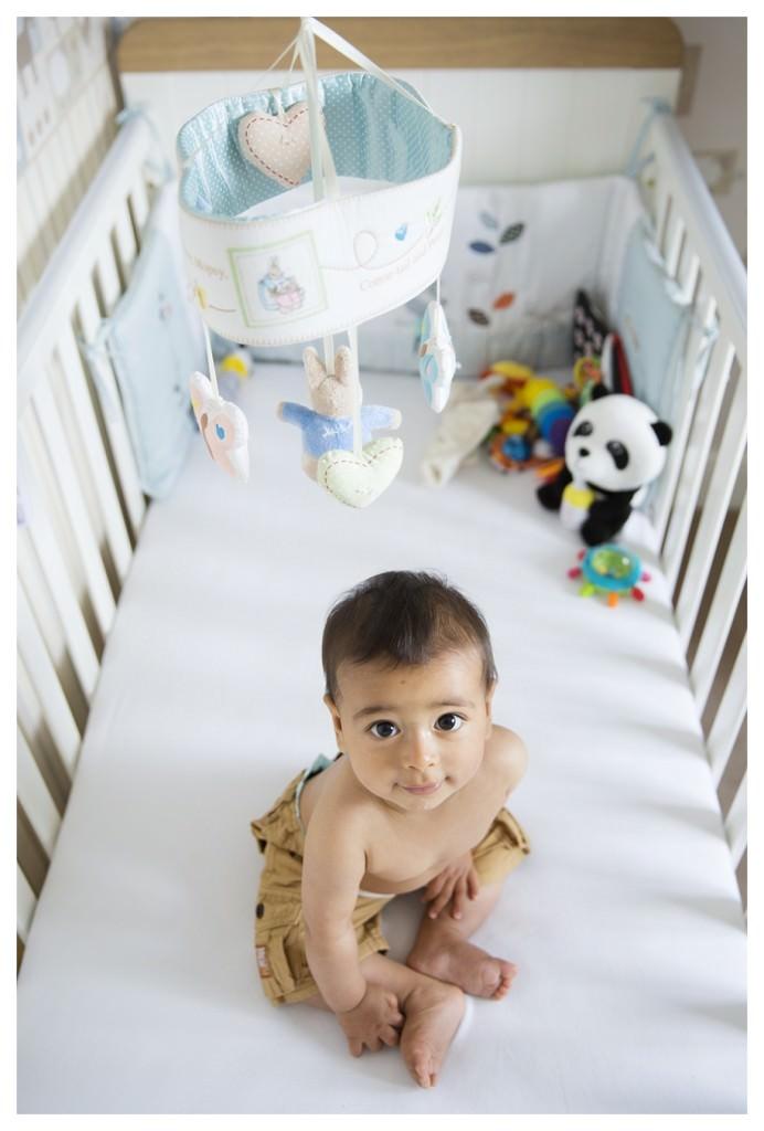 cute baby in cot