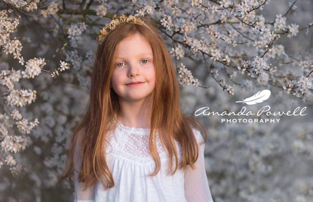 Little girl in blossom