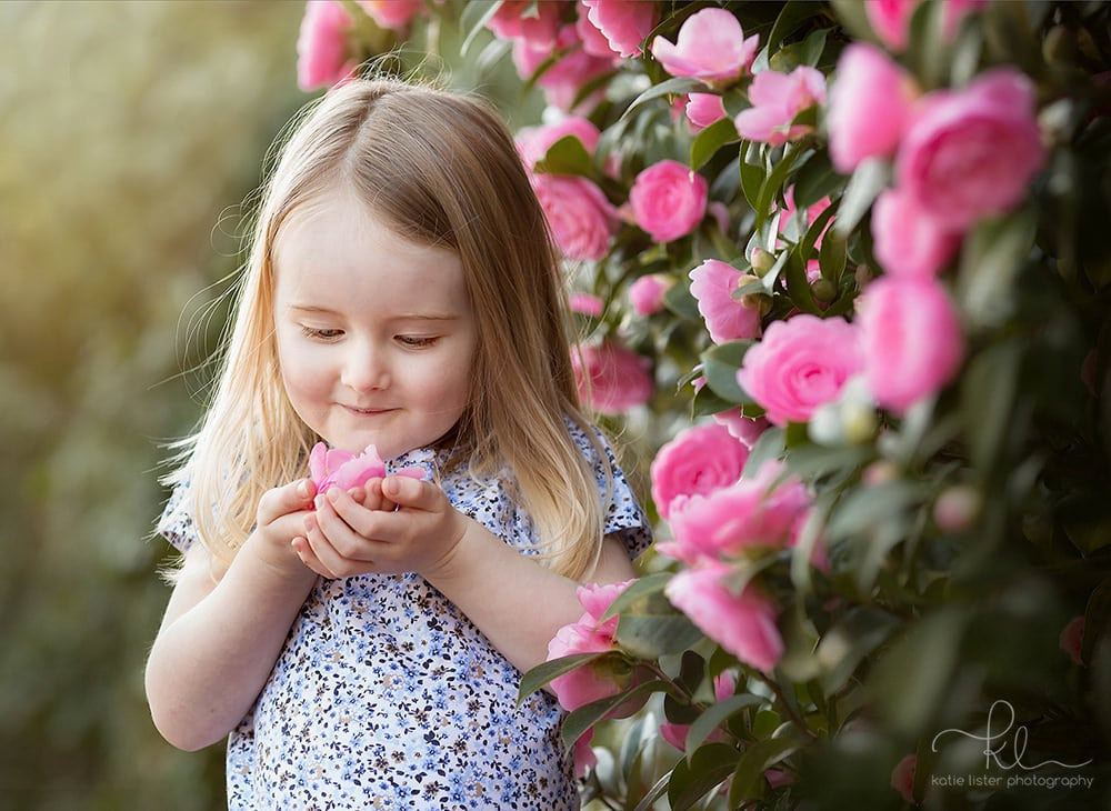 Little girl in pink flowers child photography