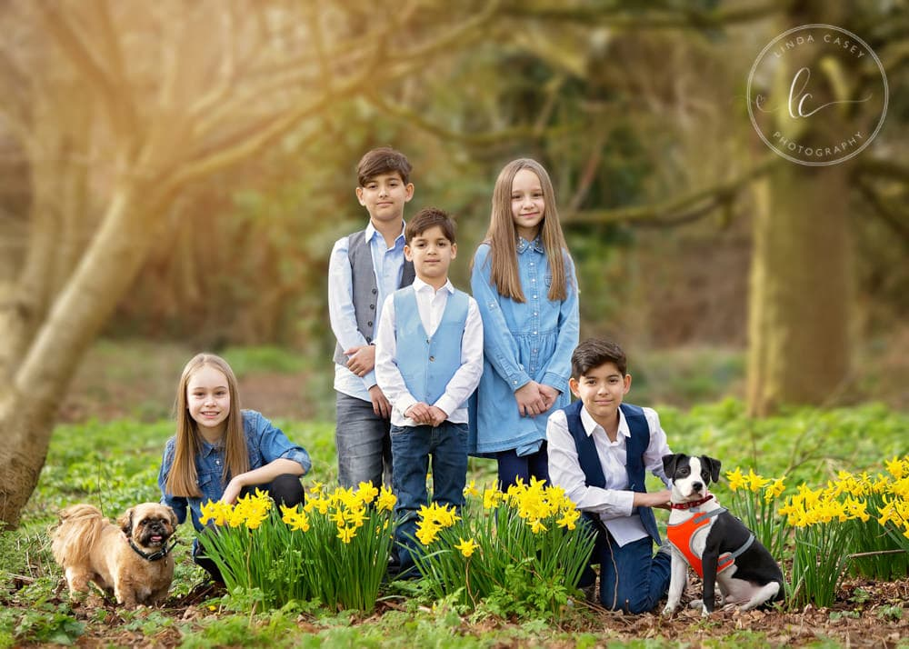 family photographed in daffodils
