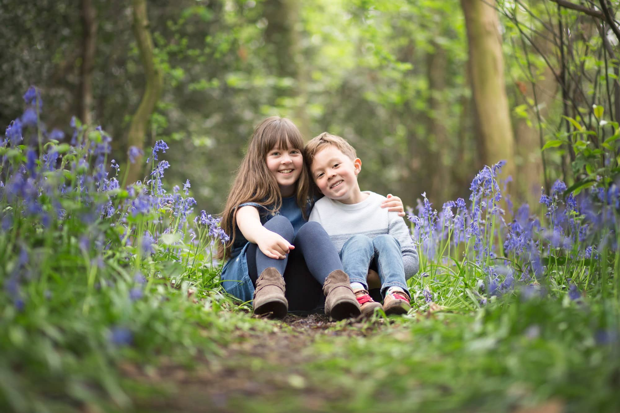 protecting the bluebells on a photoshoot