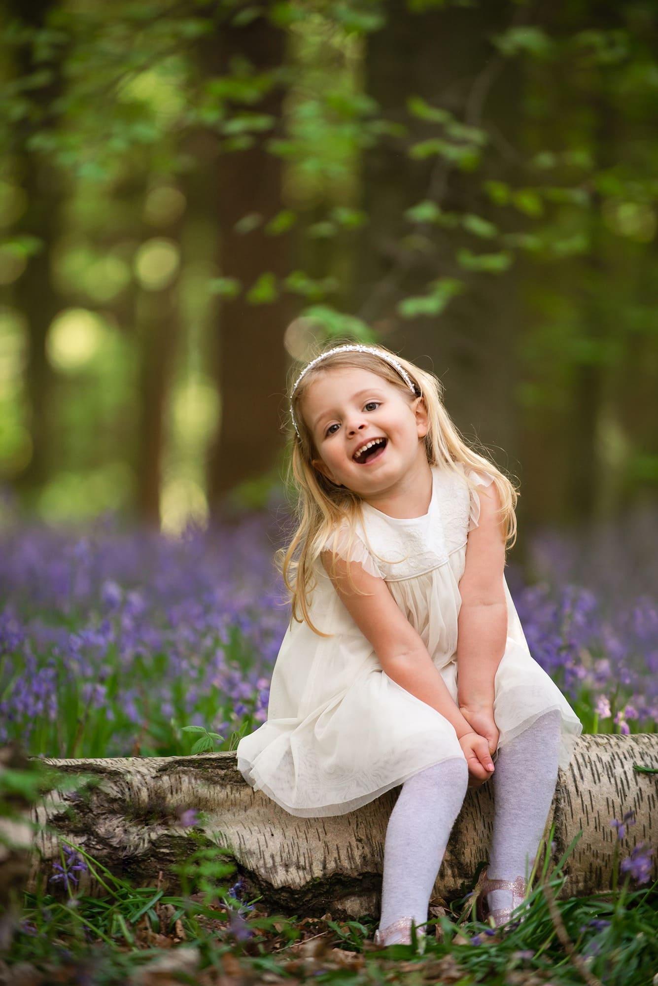 little girls potrait in bluebells